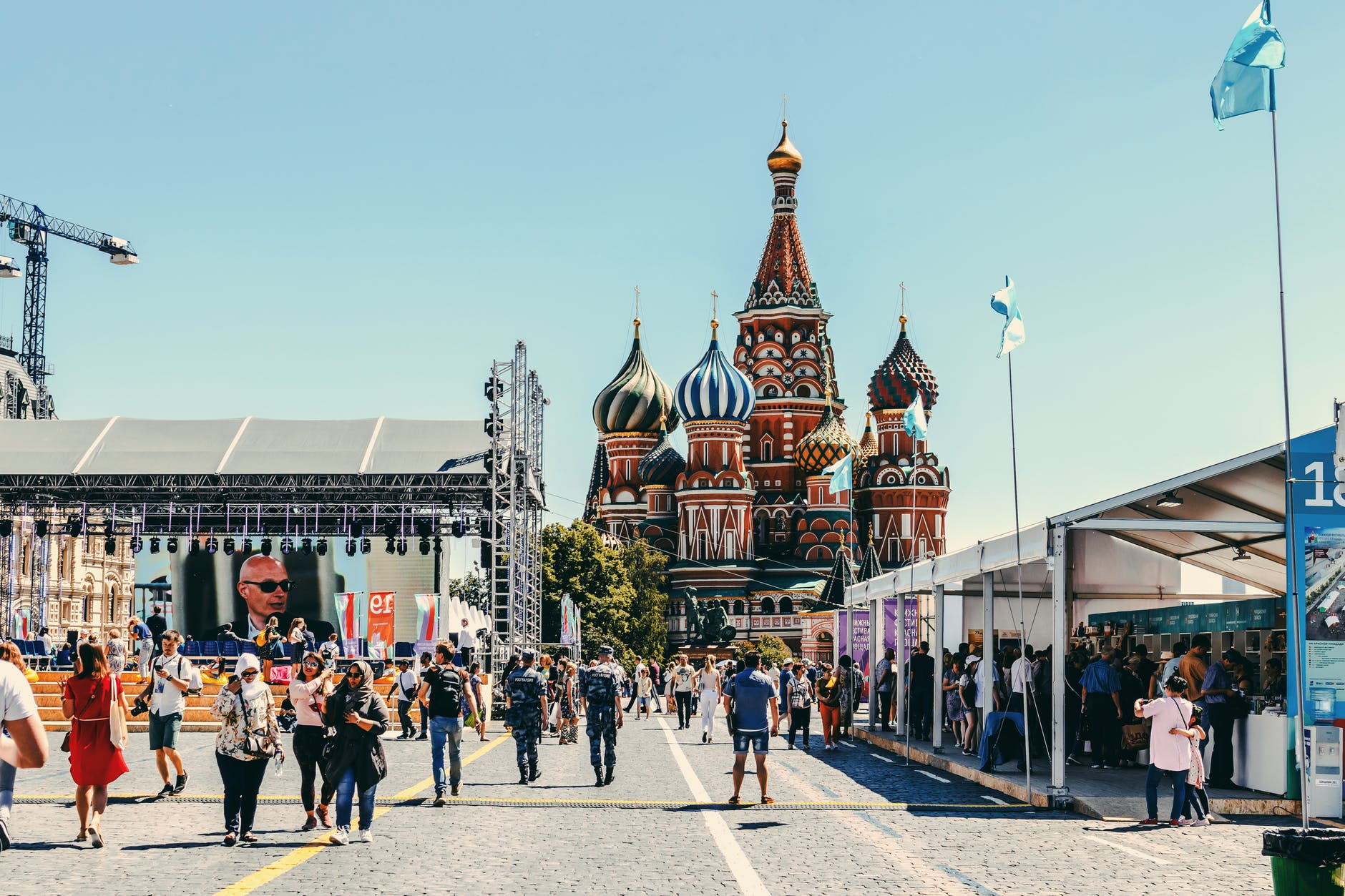 people walking near st basil s cathedral in moscow